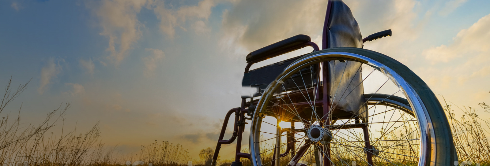 Sun shining through the spokes of a wheelchair